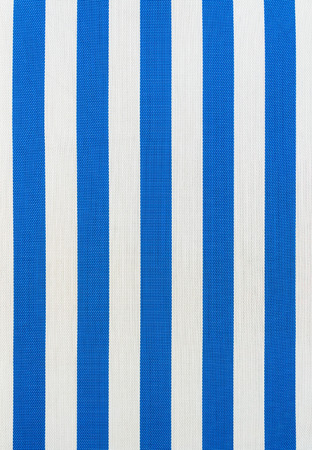 Blue and white striped fabric of an outdoor lounge chair. Stock Photo