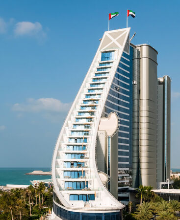 preceded: DUBAI, UAE - DECEMBER, 10, 2013  Jumeirah Beach Hotel, preceded by beachfront  Well-known for its wave-shaped silhouette, remains one of the best recognizable landmarks of Dubai, UAE