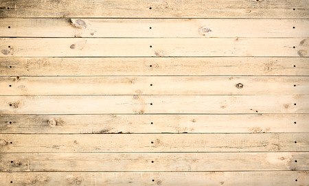 Vintage background from a wooden shabby plank. Toned image photo