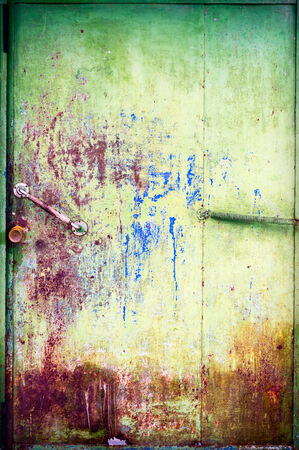 Painted and scratched rusty surface metal photo