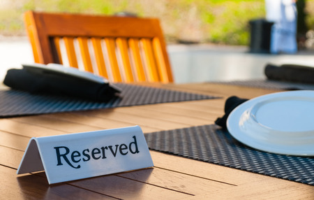 Reserved sign on a table in restaurant - selective focus photo