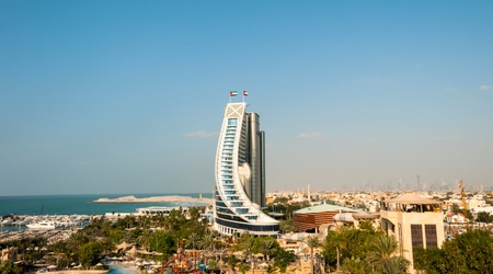 preceded: DUBAI, UAE - December 10, 2013  Jumeirah Beach Hotel, preceded by beachfront  Well-known for its wave-shaped silhouette, remains one of the best recognizable landmarks of Dubai, UAE
