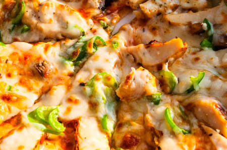Pizza with cheese, peper, chicken and mushrooms photo