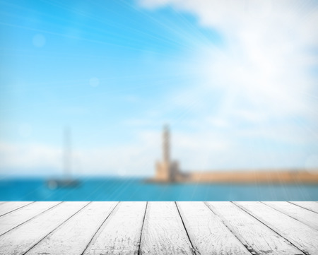 Empty wooden deck table with copyspace and bokeh background