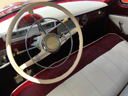 Retro car, vintage steering wheel and speedometer