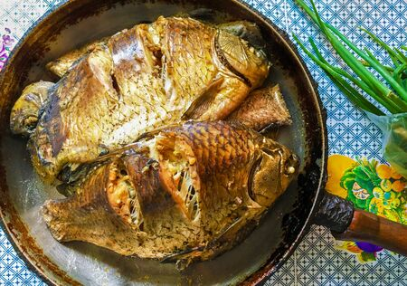 River fish crucian carp prepared in frying-pan