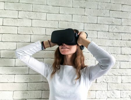 Woman looking through virtual reality device