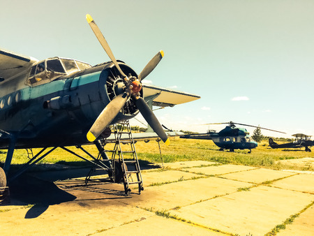 Abandoned Russian military helicopters on the field Stockfoto