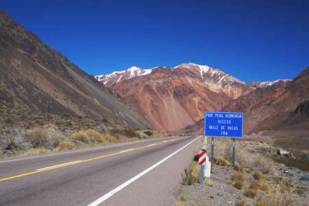 Road sing giving you a welcome to Aconcagua provincial park, Mendoza, Argentina.
