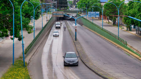 """Temperley underpass and """"9 de julio"""" avenue view with a few cars going by Stock Photo"""