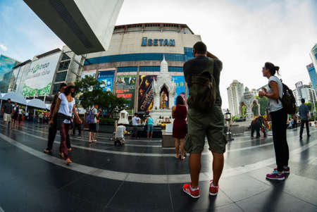 westerner: westerner tourists taking photos of locals Editorial