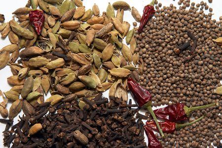 gastronome: Aromatic spices. Cardamom, coriander, cloves, pepper Stock Photo