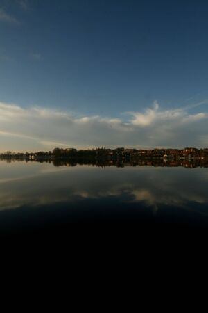 reflektion: Sky and town refleted in a lake