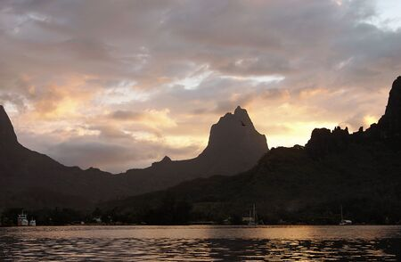 Red sunset on Cooks Bay in Moorea, French Polynesia. photo