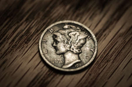 dime: Closeup image of an antique mercury dime.