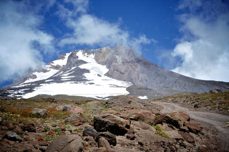 barely: A cloudy shot of Mount Hood with some snow, ski lifts are barely visible. Stock Photo