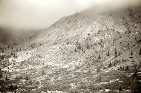 helens: The erosion of one side of Mount Saint Helens on a foggy day