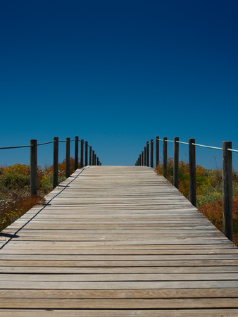 foot bridges: Wooden path to the beach Stock Photo