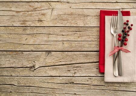 holiday meal: Cutlery kitchenware on old wooden boards background
