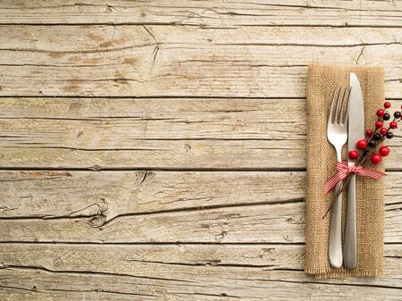 rustic food: Cutlery kitchenware on old wooden boards background