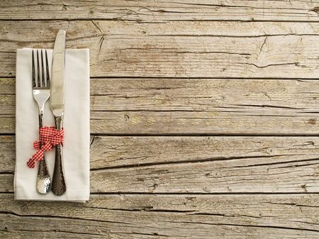 tied down: Cutlery kitchenware on old wooden boards background