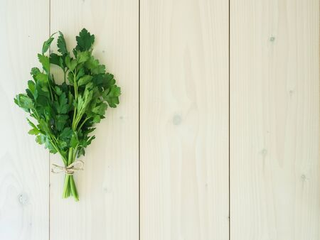 parsley on wooden background. top view