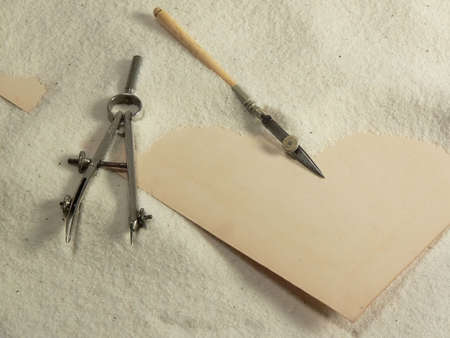 Antique tools and vintage paper buried in Sand