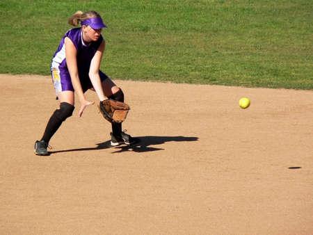 high school sports: Girl Softball Player (trademarks removed)