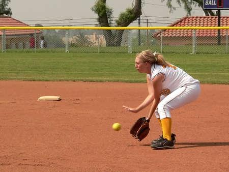 removed: Girl Softball Player (trademarks removed)
