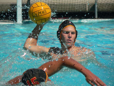 waterpolo: Water Polo player throwing a ball Stock Photo