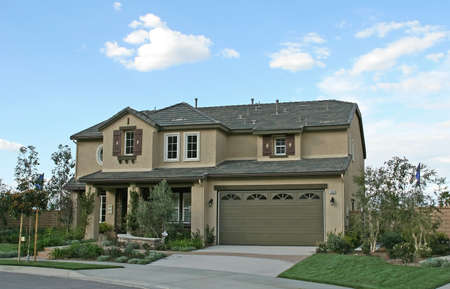 The exterior facade of a new model home in a new community