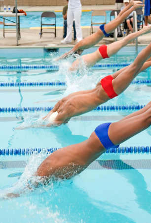 A high school swim meet for competitve athletes and spectators