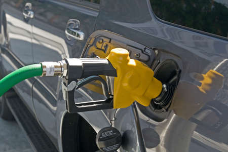 A gasoline station filling nozzle in a gas tank