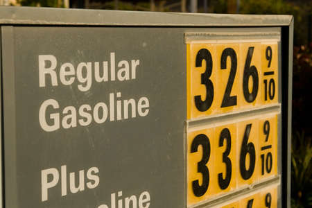 The sign of the time - high gasoline prices everywhere Foto de archivo