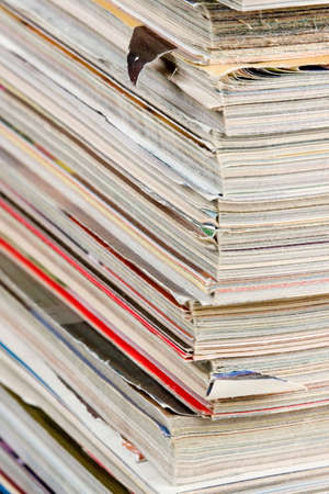 quarterly: A neat, tall stack of old and worn magazines