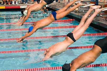 The swimmers compete hard in the high school league championships Banco de Imagens - 906892