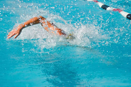 The swimmers compete hard in the high school league championships