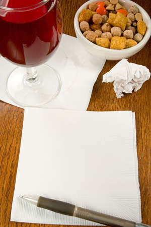 Ideas, charts, innovation on a cocktail napkin in a bar with wine and snacks photo