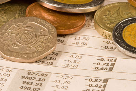 International currency and coins from around the world for business success. photo