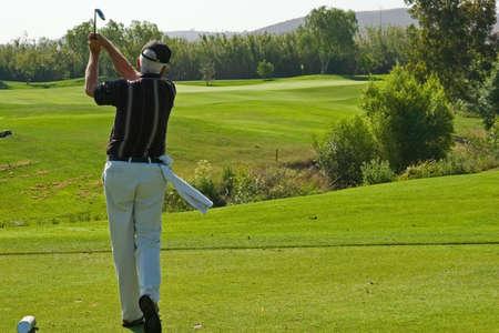golfing: Golfbaan en spelers raken de greens