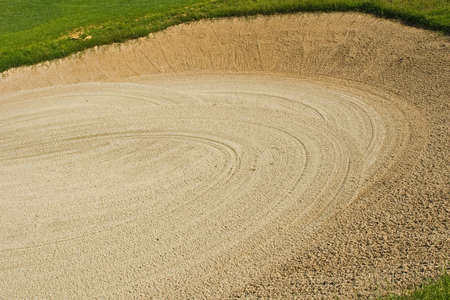raked: Golf course action and players hitting the greens Stock Photo