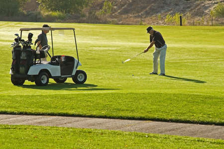 golfcourse: A golf course and senior golfers in action