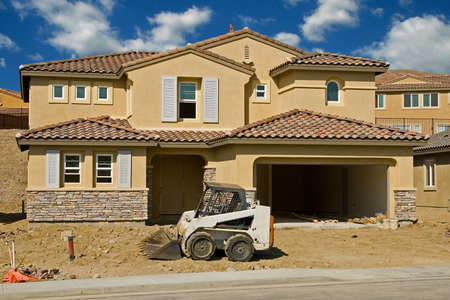 roof tiles: New residential construction in a subdivision of a new community Stock Photo