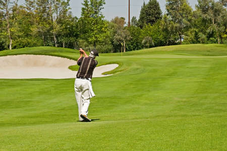 Golf course action and players hitting the greens Stock Photo