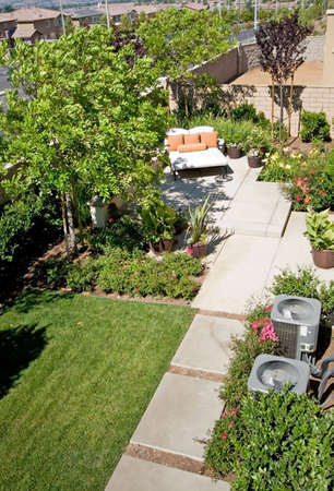 retreat: Backyard oasis and suburban retreat with flowers, lounge chair, and patio