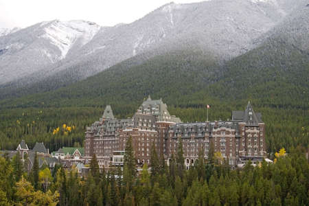 towering: Towering Rocky Mountains covered in winter snow in Alberta, Canada while on a vacation travel holiday