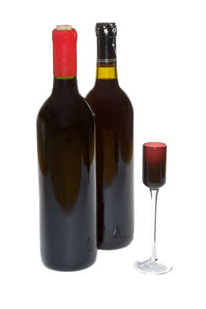 cordial: Red wine bottles and a small cordial glass