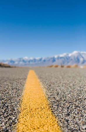 lane marker: Close up of a desert highway lane marker Stock Photo