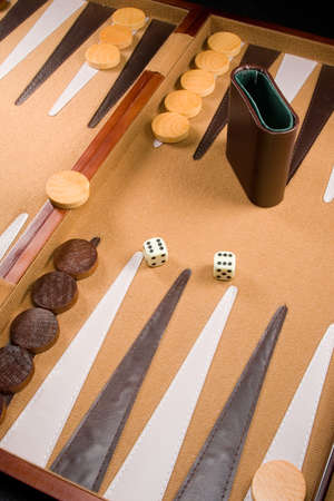 gambling stone: Backgammon game board with dice, pieces, and bars