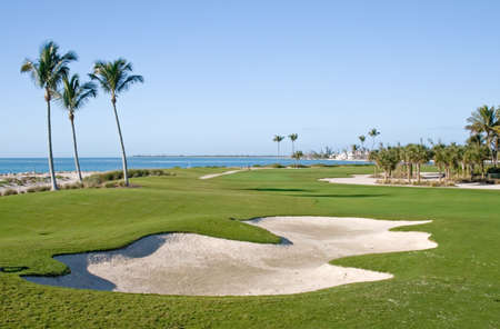 of course: Golf course resort scenes of players and holes